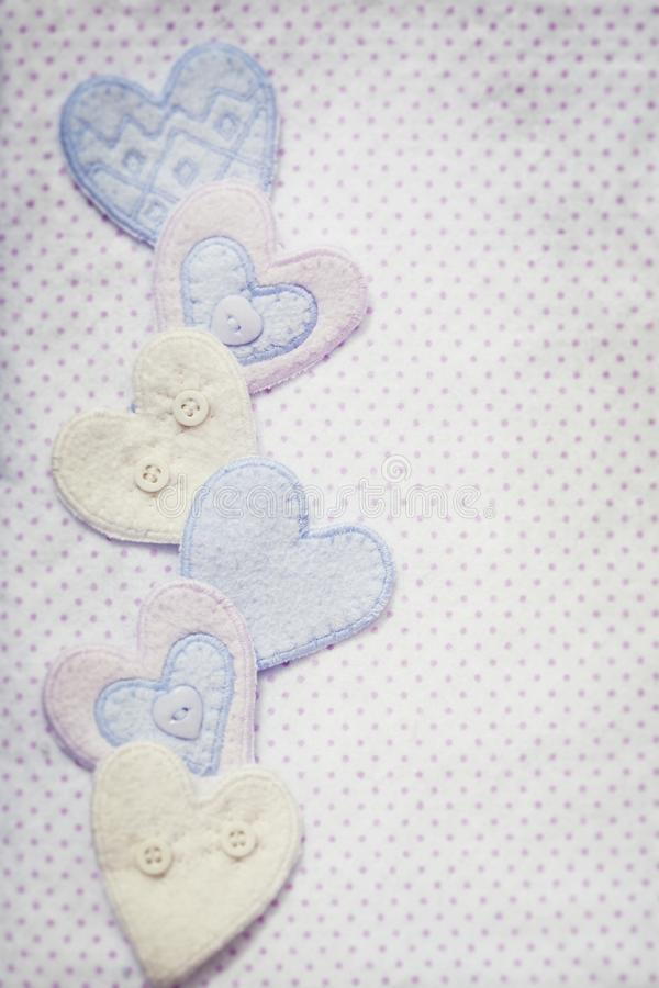 Pastel Hearts with Baby blanket motif Background stock image