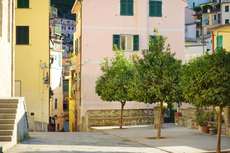 Pastel houses of Riomaggiore, the largest of the five centuries-old villages of Cinque Terre, Italian Riviera, Liguria, Italy. Pastel houses of Riomaggiore, the stock photo