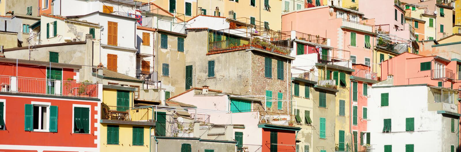Pastel houses of Riomaggiore, the largest of the five centuries-old villages of Cinque Terre, Italian Riviera, Liguria, Italy. Pastel houses of Riomaggiore, the royalty free stock photos