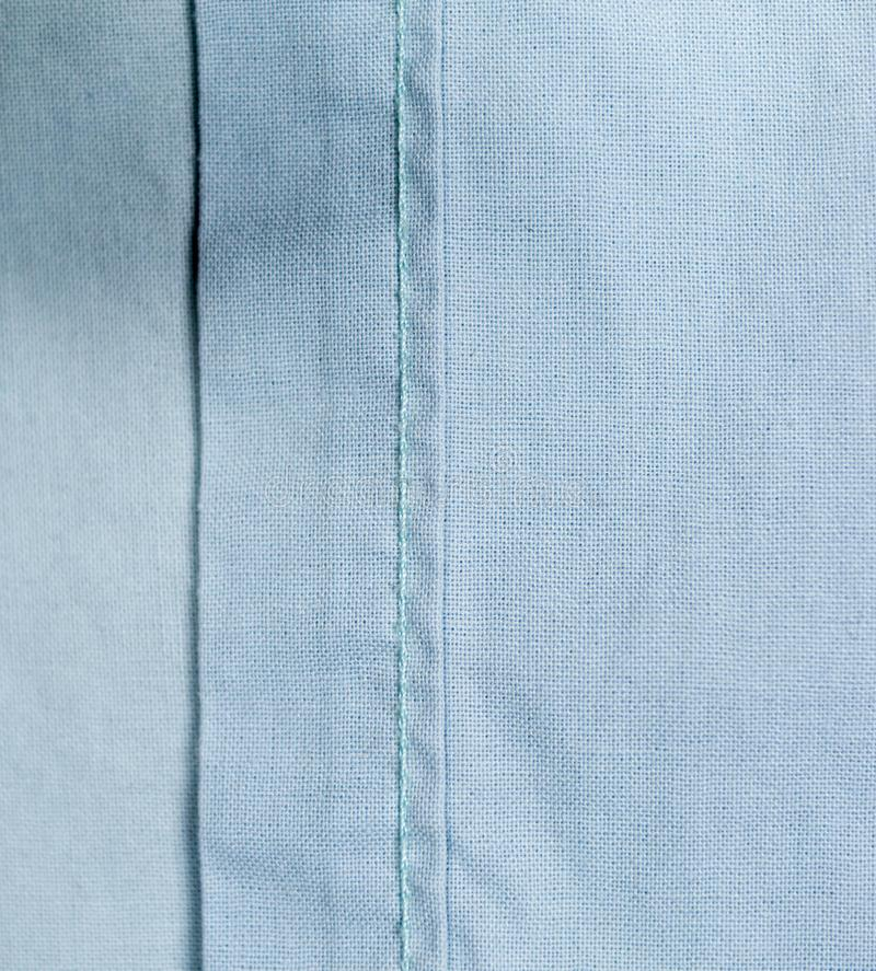 Light blue cloth fabric textile background. texture. stock images