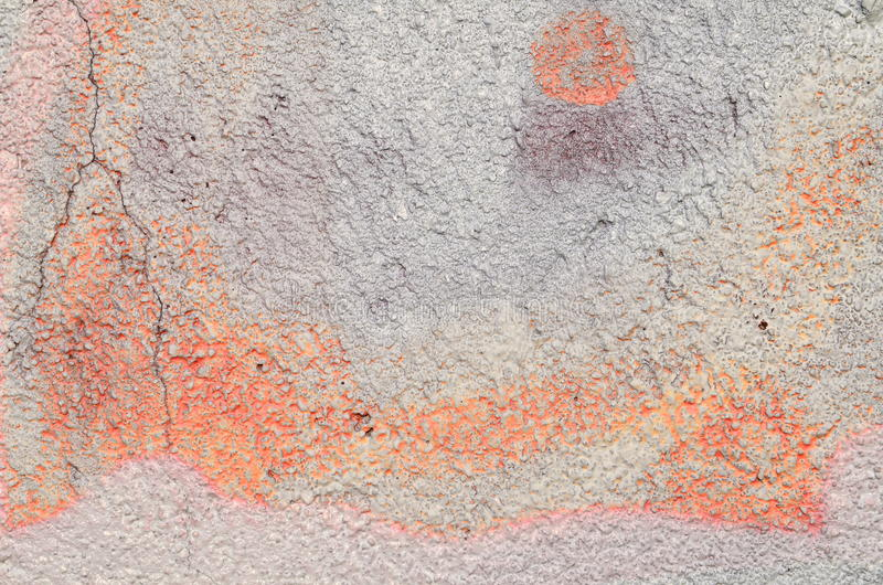 Pastel painted plaster. Rough plastered wall airbrushed with white and orange colors royalty free stock photo
