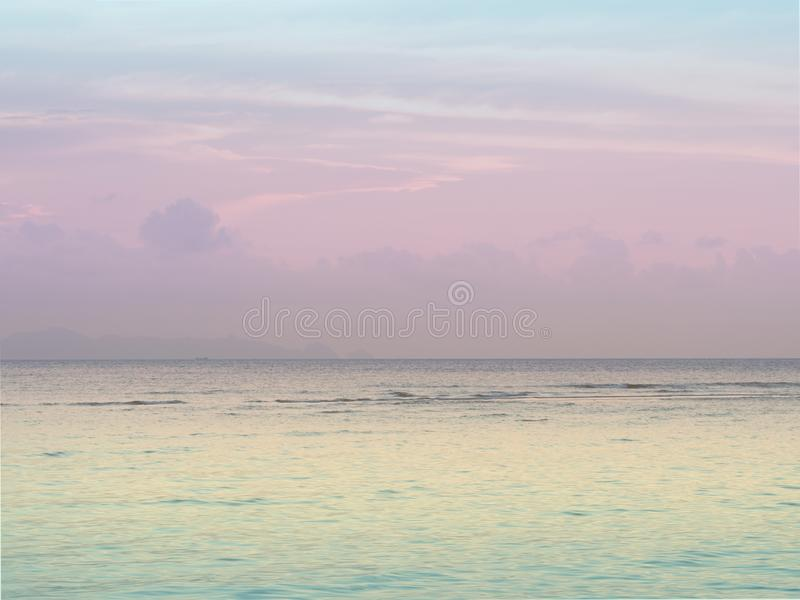 Pastel peaceful scene of a calm ocean sea and sunset sky stock images