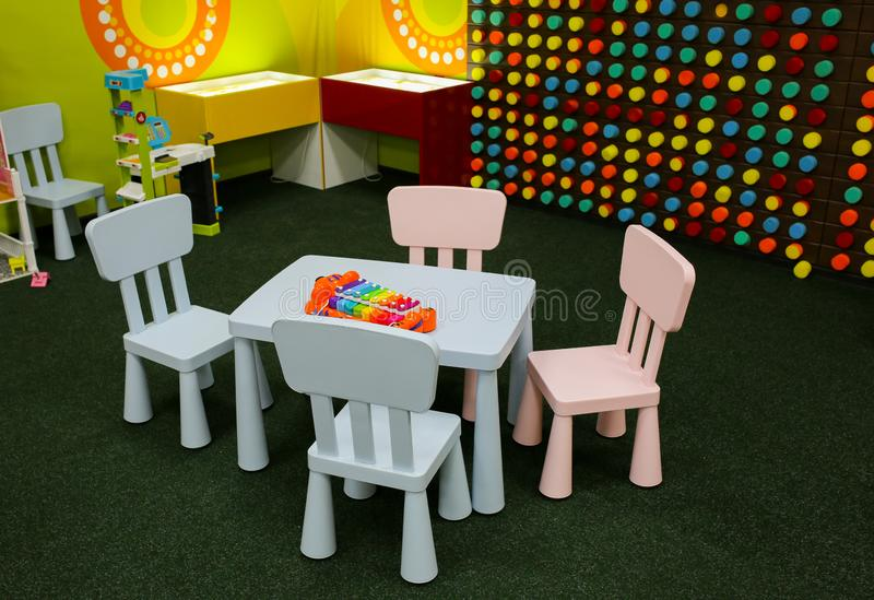 Pastel pink and blue children table with chairs. Entertainment center or room in the house. Children free time. Bright xylophone. On toddler`s small table and stock photo