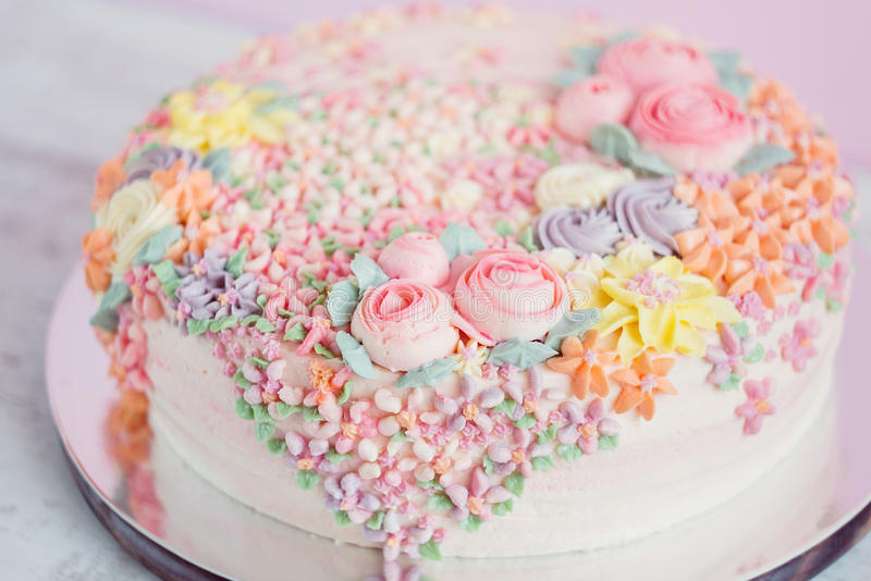 Pastel Pink Cake Decorated With Cream Flowers Stock Photo