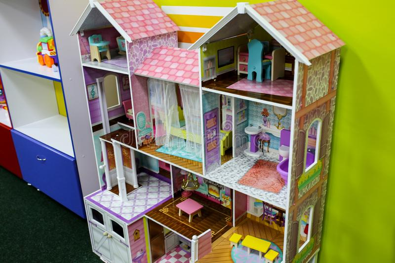 Pastel pink doll house. Games for girls in the entertainment center or at home. Children free time. Retro play kitchen in vintage royalty free stock images