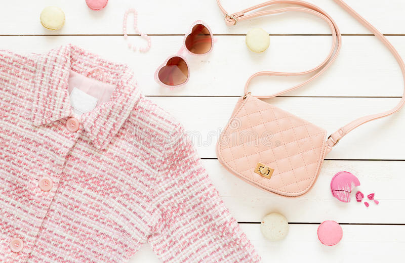 Pastel pink jacket and fashion accessories for girls royalty free stock photo