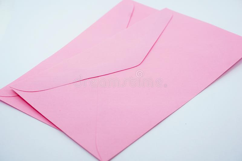 Pastel pink paper envelope Small size. On a white background royalty free stock photo