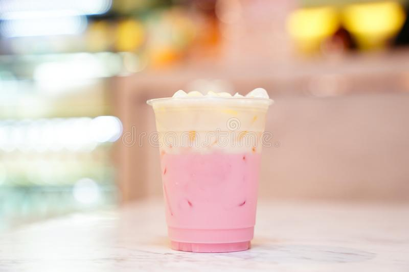 Pastel shades Pink milk with whipping cream royalty free stock photography