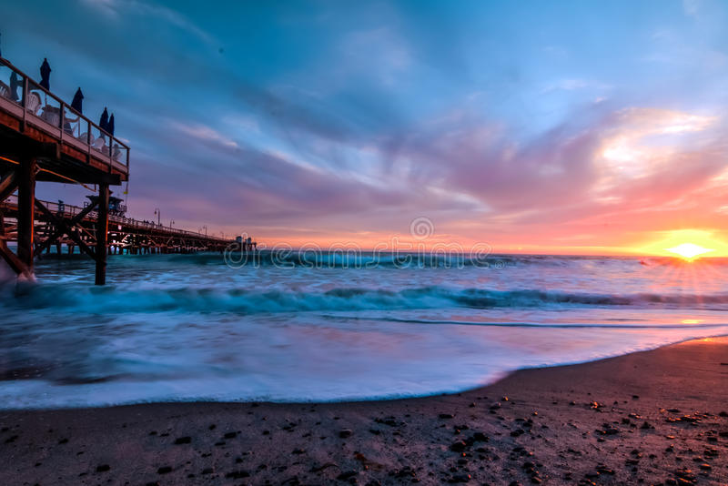 Pastel sunset in San Clemente, Clifornia. Pink, orange, and blue sky over at san clemente pier royalty free stock photo
