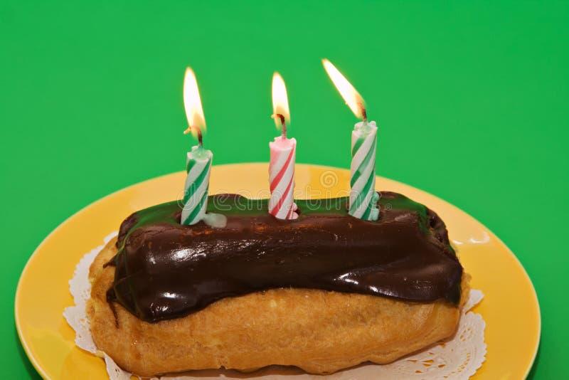 Pastelaria do Eclair do aniversário imagens de stock