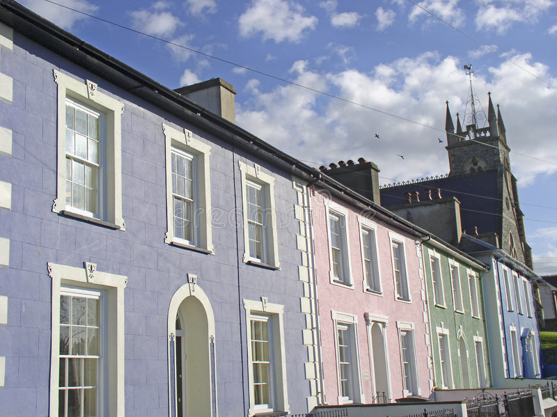 Pastelkleur-gekleurd housefronts stock foto