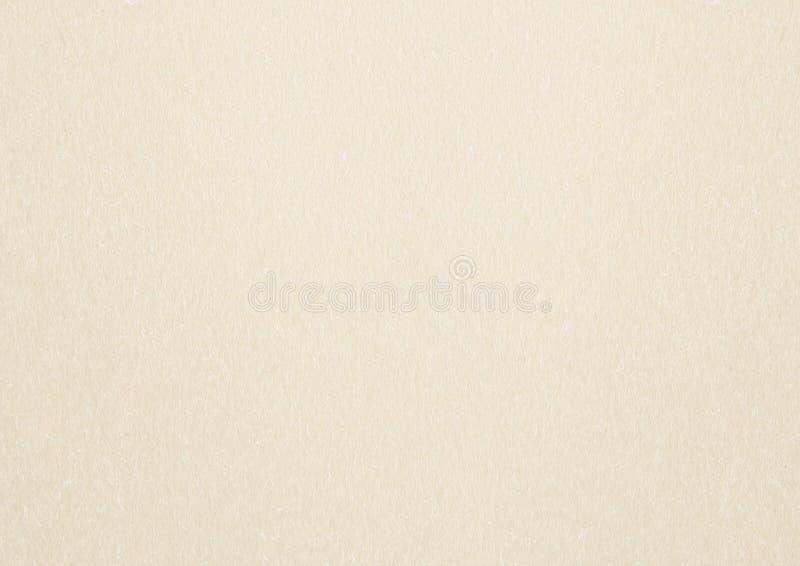 Pastellfärgad neutral bakgrund för papper för modell för sandfärgmode royaltyfria foton
