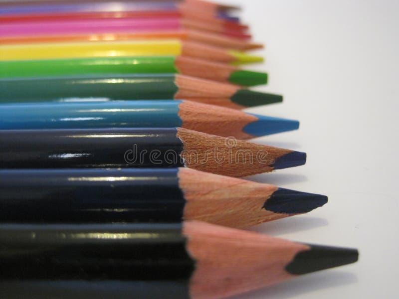 Pastelli di legno della matita di coloritura su un fondo bianco fotografia stock