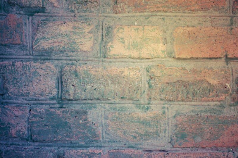 Pastello d'annata del muro di mattoni con le vecchie sbavature della pittura Blu, crema e fotografia stock