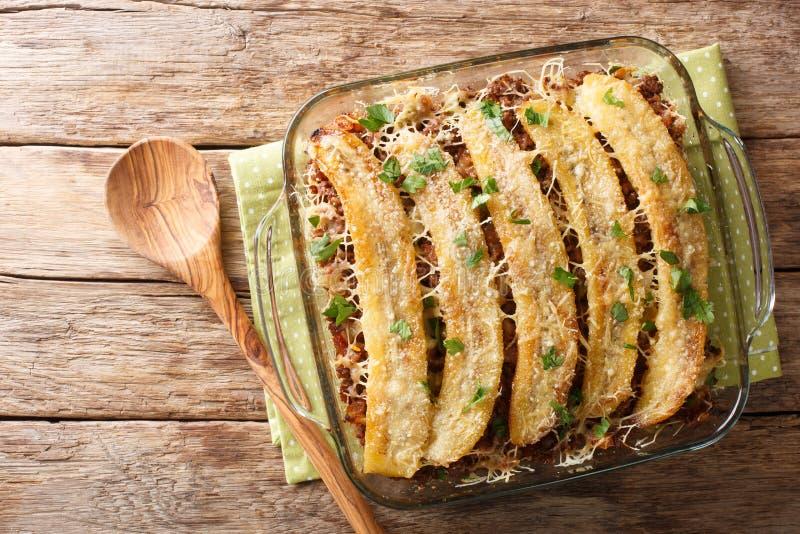 Pastelon de Platano Maduro is a close-up of banana lasagna in a baking dish. Horizontal top view stock image