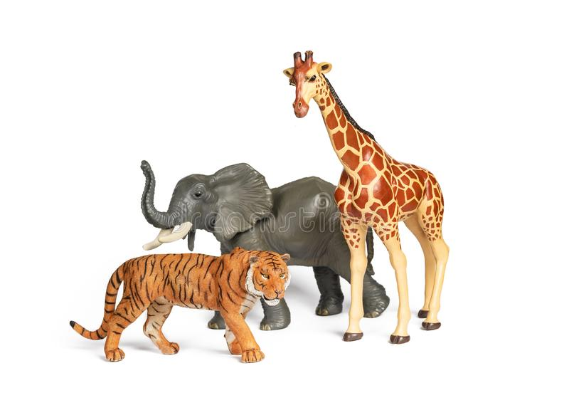 Plastic wild african animal toys isolated on white. Tiger, Elephant and giraffe. Children animal characters for playing zoo game royalty free stock image