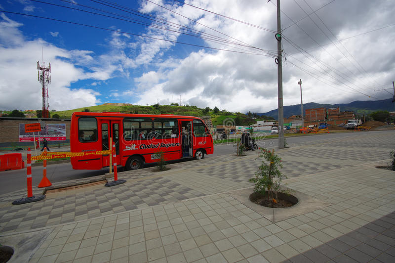 PASTO, COLOMBIA - JULY 3, 2016: public bus with some passenger inside driving trough the city stock photography