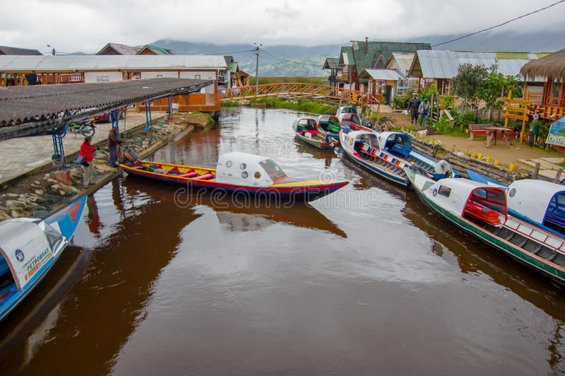 PASTO, COLOMBIA - JULY 3, 2016: some boats parked in the port of a small location in la cocha lake stock image