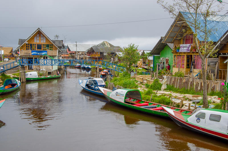 PASTO, COLOMBIA - JULY 3, 2016: some boats parked on the river close to la cocha lake royalty free stock photos