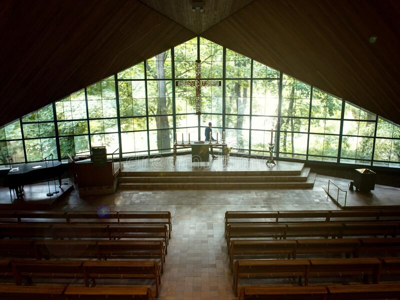 Pastor in its church looking outside the window royalty free stock photos