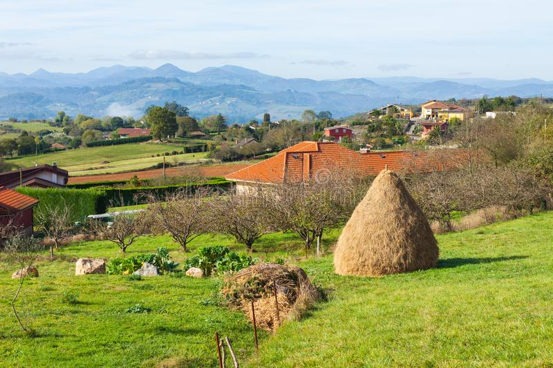 Pastoral landscape of Escamplero village with a haystake in the foreground. Asturias. Spain royalty free stock images