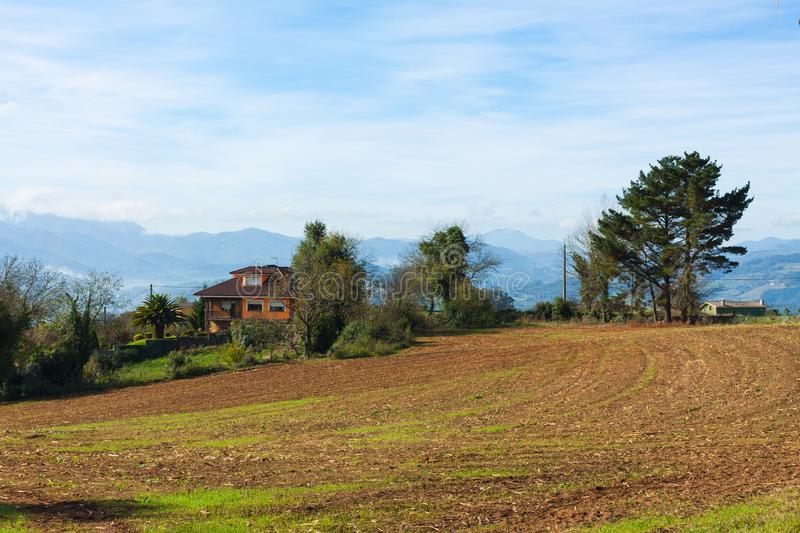 Pastoral landscape of Escamplero village with mountains in the background. Asturias. Spain stock photography