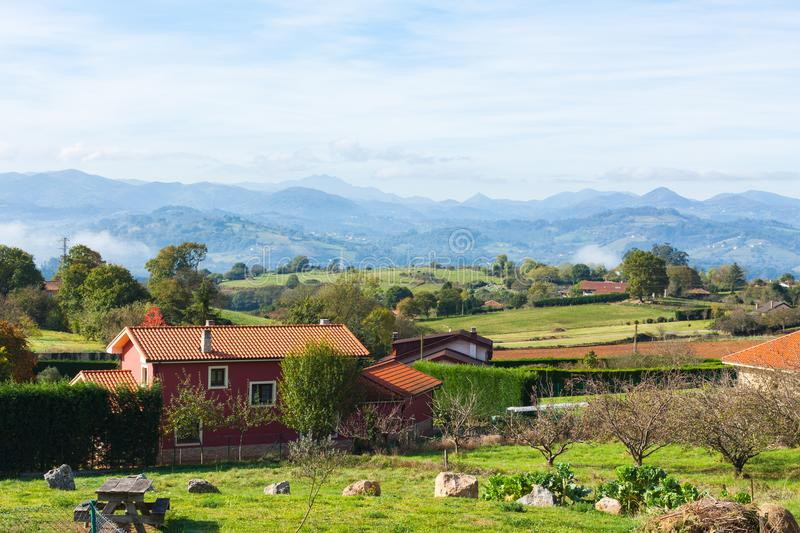 Pastoral landscape of Escamplero village with mountains in the background. Asturias. Spain stock photos