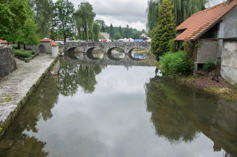 The pastoral view on French Bridge over the Bistrica River. In Ribnica town. Slovenia royalty free stock images