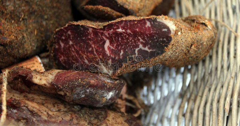 Pastrami or pastramy is a highly seasoned smoked beef, typically served in thin slices. Pastterma is a delicacy of beef, sheep, po royalty free stock photography