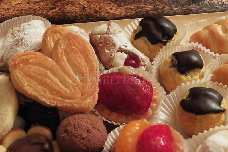 Pastries with fruit and chocolate table stock photography