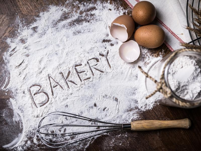 Pastry Baking Accessories Bakery Background with bakery text writing on flour. Ingredients for the preparation of bakery products. Pastry Baking Accessories stock photography