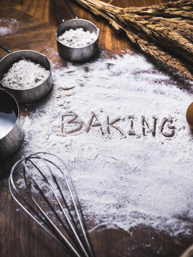 Pastry Baking Accessories Bakery Background with baking text writing on flour. Ingredients for the preparation of bakery products. Pastry Baking Accessories stock photo