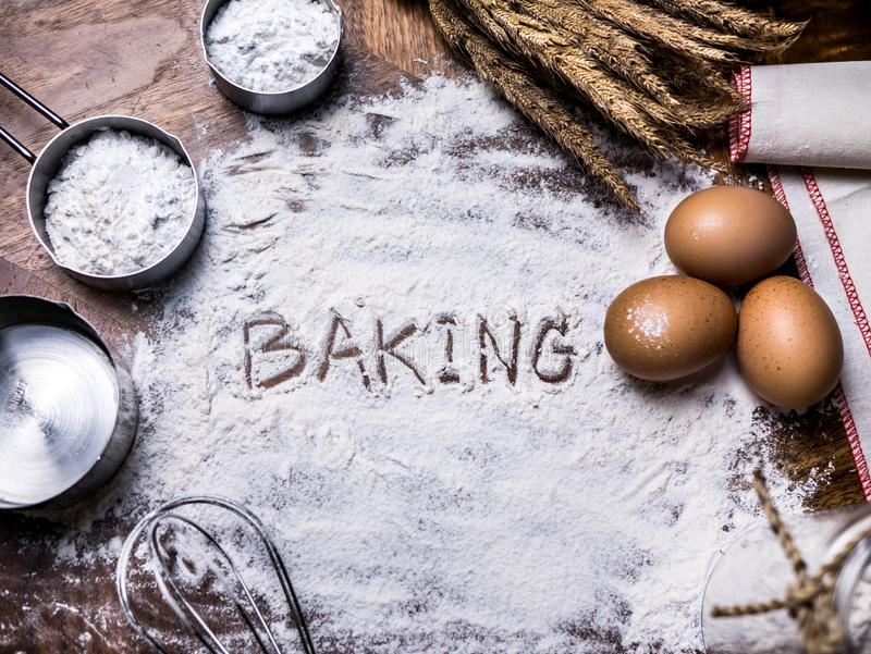Pastry Baking Accessories Bakery Background with baking text writing on flour. Ingredients for the preparation of bakery products. Pastry Baking Accessories royalty free stock photos