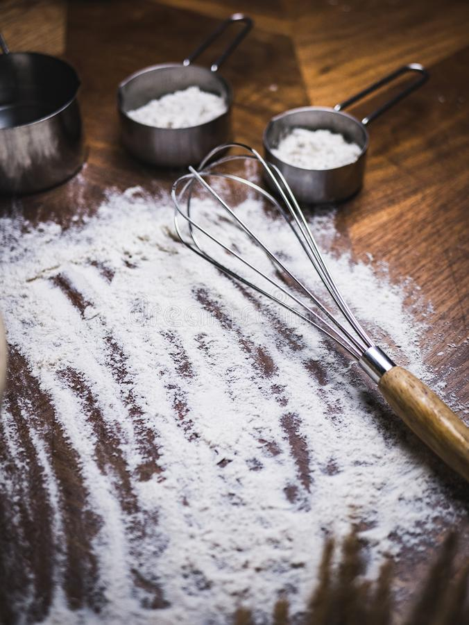 Pastry Baking Accessories Bakery Background with flour and whisk.  royalty free stock photos