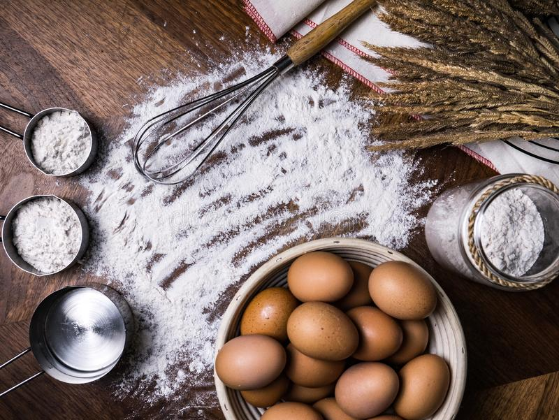 Pastry Baking Accessories Bakery Background with flour and whisk.  royalty free stock photography