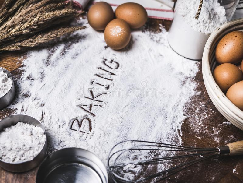 Pastry Baking Accessories Bakery Background with baking text writing on flour. Ingredients for the preparation of bakery products. Pastry Baking Accessories royalty free stock images