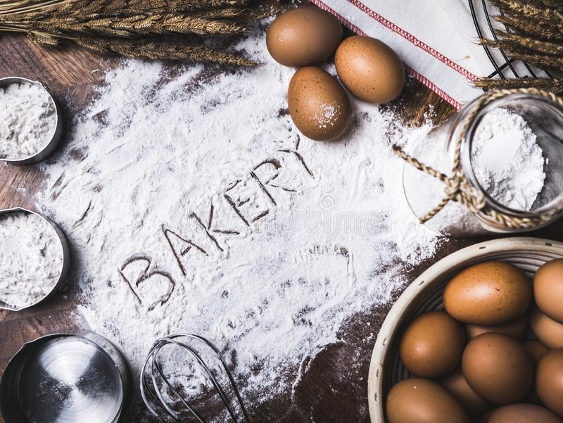 Pastry Baking Accessories Bakery Background with bakery text wri. Ting on flour royalty free stock photos