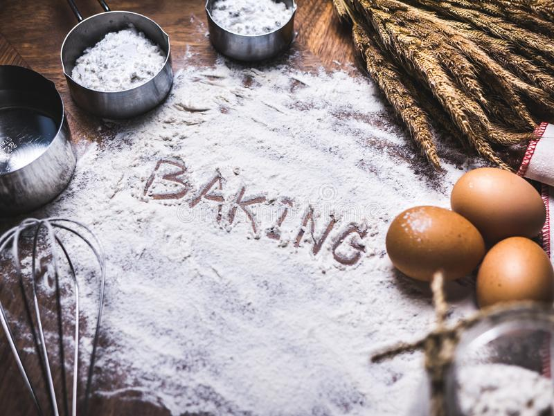 Pastry Baking Accessories Bakery Background with baking text writing on flour. Ingredients for the preparation of bakery products. Pastry Baking Accessories royalty free stock photography