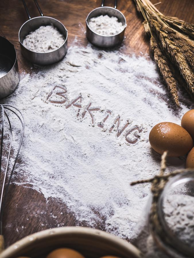 Pastry Baking Accessories Bakery Background with baking text writing on flour. Ingredients for the preparation of bakery products. Pastry Baking Accessories royalty free stock photo