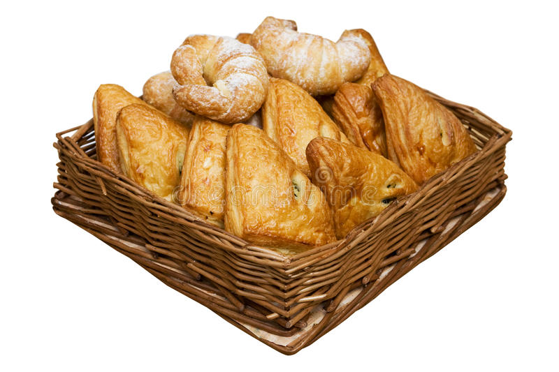 Pastry basket. Wicker basket with selection of French & Danish pastries on white background royalty free stock photos