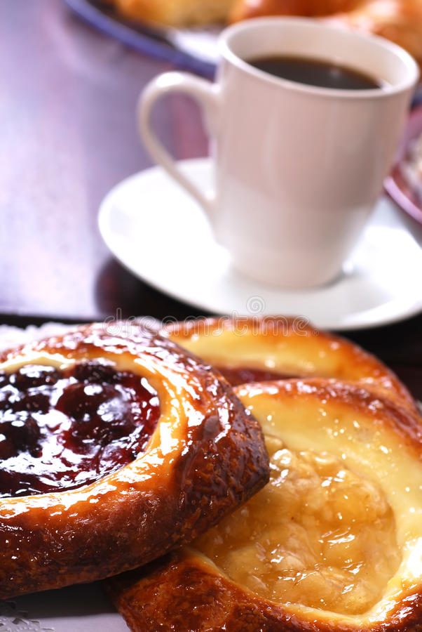 Pastry Breakfast. Plates full of assorted pastries with coffee in a bakery stock image