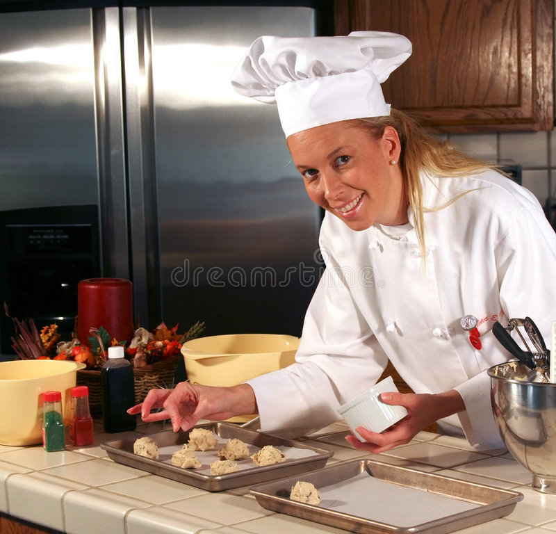 Pastry Chef. In kitchen making chocolate chip cookies royalty free stock photo
