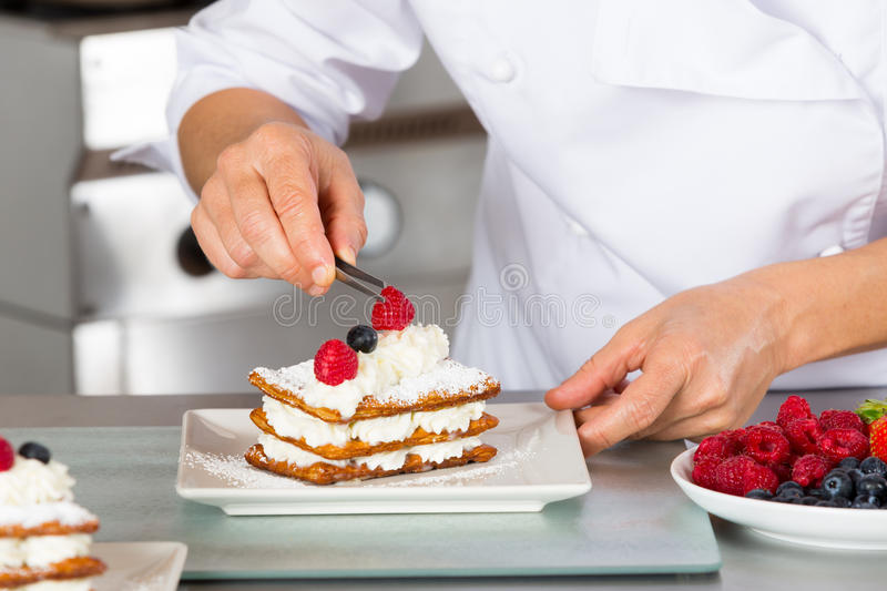 Pastry chef decorating royalty free stock images