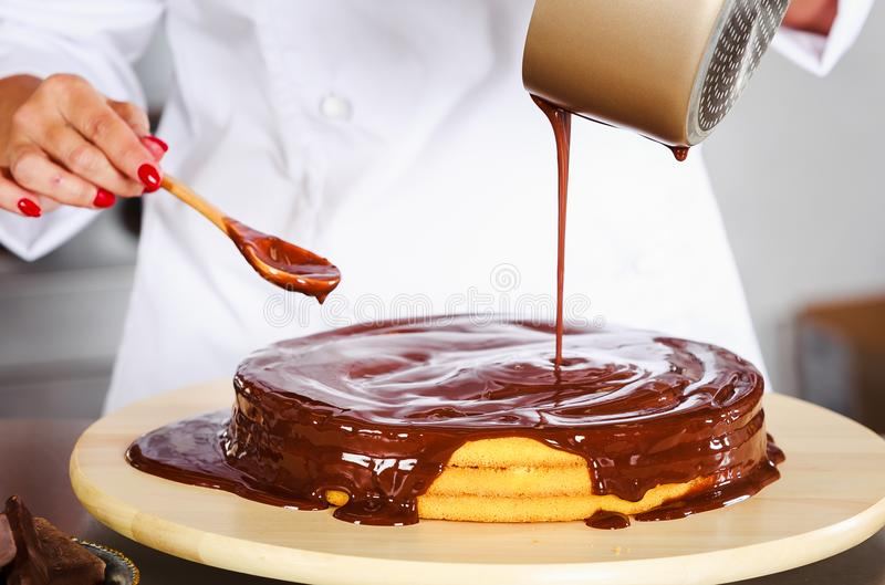 Pastry chef in the kitchen royalty free stock photography