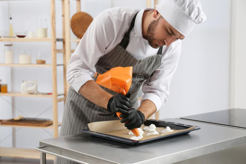 Pastry chef preparing meringues at table stock photography