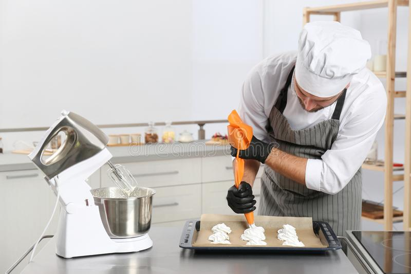 Pastry chef preparing meringues at table stock photos