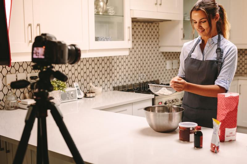 Pastry chef vlogging in kitchen royalty free stock photos