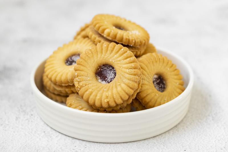 Pastry desert jam cookie with strawbey jam isolated , sweet snack royalty free stock photo