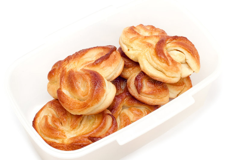 Pastry filled with custard stock images