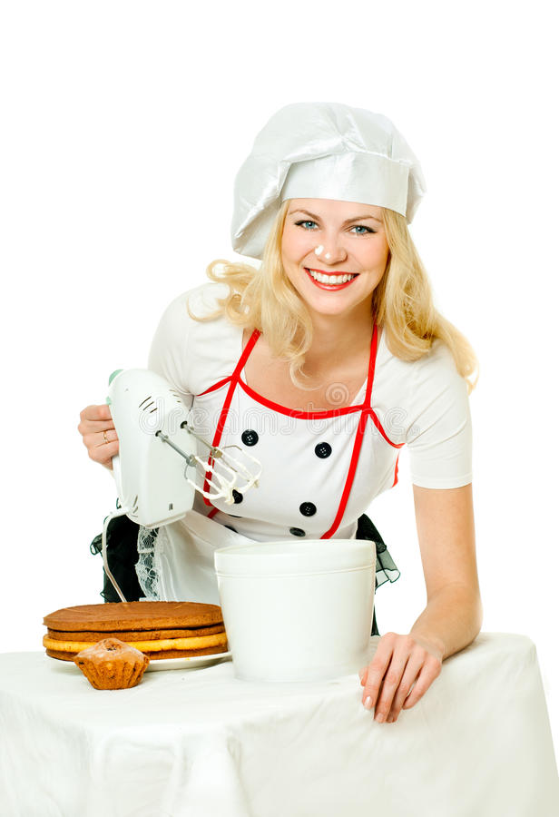 Pastry girl. Girl pastry blender whips cream stock photography
